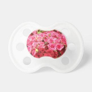 Chupete Flores en los rosas de Filipinas, rosados y rojos