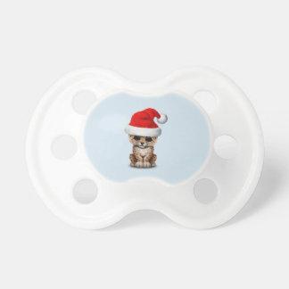 Chupete Leopardo lindo Cub que lleva un gorra de Santa