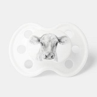 Chupete MOO una vaca joven del jersey