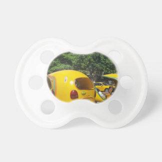 Chupete Taxis amarillos brillantes de los Cocos de la