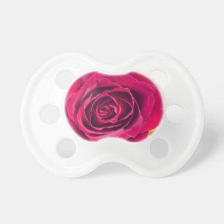 Chupete Un rosa rojo