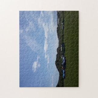 Cielos azules sobre rompecabezas de la foto del