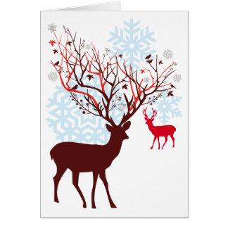Ciervos del navidad con las astas de la rama de tarjeta de felicitación