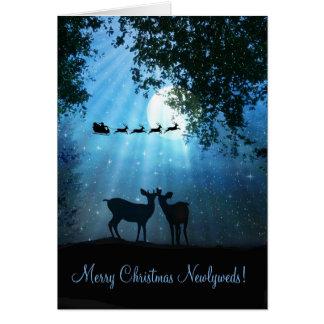 Ciervos lindos en la tarjeta de Navidad del recién