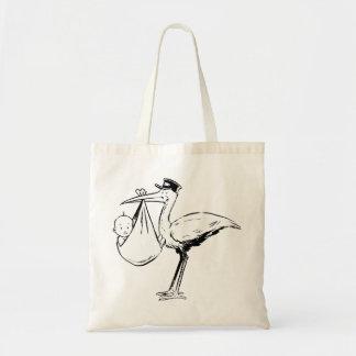 Cigüeña que sostiene una bolsa de asas del bebé