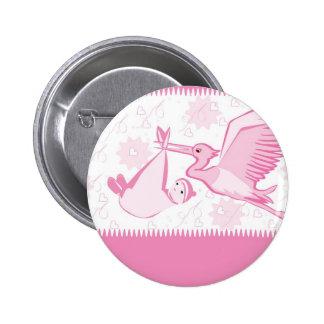 Cigüeña rosada con el botón del bebé