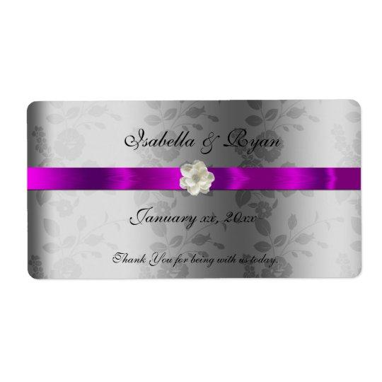 Cinta y flor púrpuras de la etiqueta del agua del