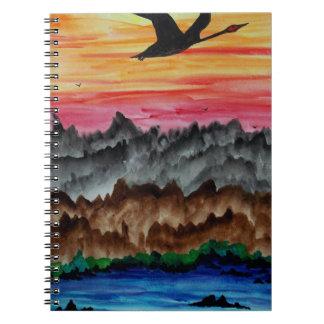 Cisnes negros en la puesta del sol cuaderno