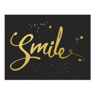 Cita de la sonrisa del oro postal