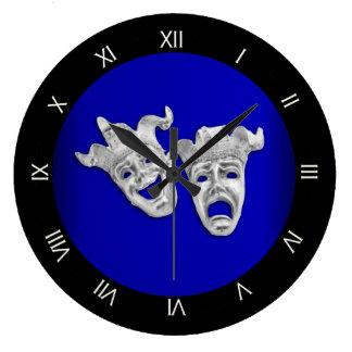 Cobalto de las máscaras del teatro de la comedia y reloj redondo grande