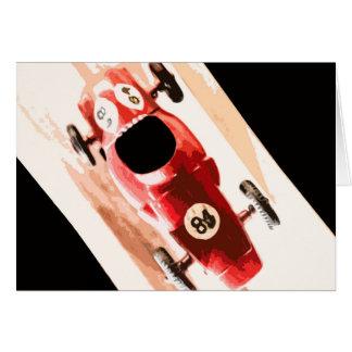 Coche del juguete en pista de madera tarjeta de felicitación
