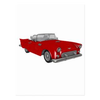 Coche rojo clásico de los años 50 postal