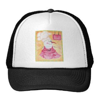 Cocinero del muñeco de nieve en gorra del delantal