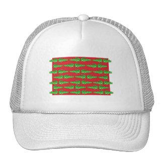 Cocodrilos verdes en rojo gorros