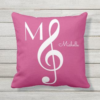 Cojín Decorativo rosa con monograma de la nota musical del clef