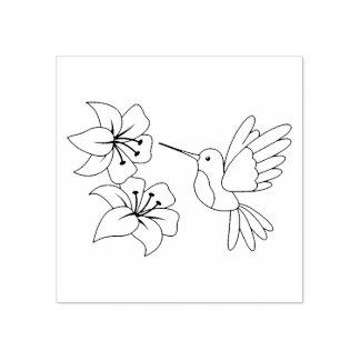 Colibrí cerca de las flores sello de caucho