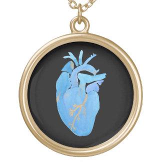 Collar anatómico del corazón del azul y del oro