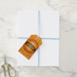 Colosseum en un botón con los elementos florales etiquetas para regalos