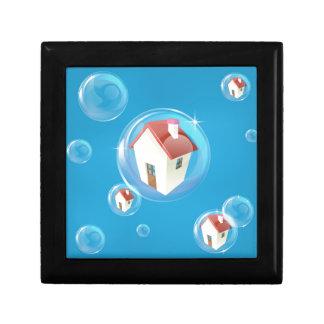 Concepto de la burbuja de vivienda cajas de recuerdo