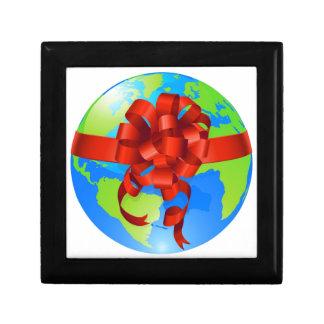 Concepto del arco del regalo del mundo del globo caja de regalo