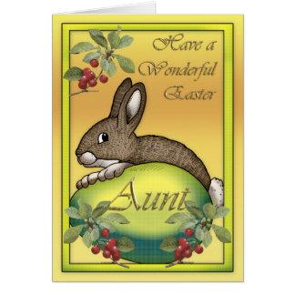 Conejito de pascua feliz con el huevo, para la tía tarjeta de felicitación