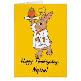Conejito y magdalena felices del sobrino de la tarjeta de felicitación