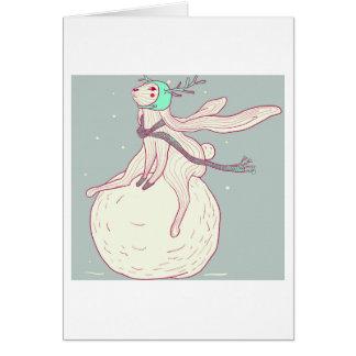 Conejo del invierno y bola de la nieve tarjeta de felicitación