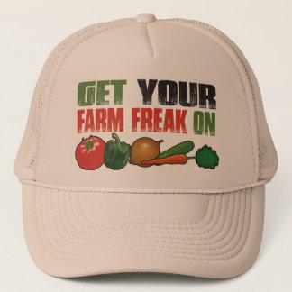 Consiga su monstruo de la granja en el gorra