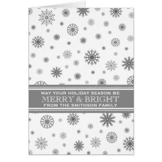 Copos de nieve del blanco gris felices y navidad tarjeta de felicitación