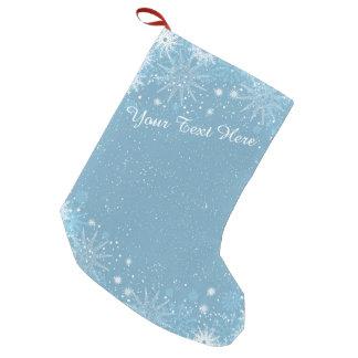 Copos de nieve en la media azul calcetín navideño pequeño