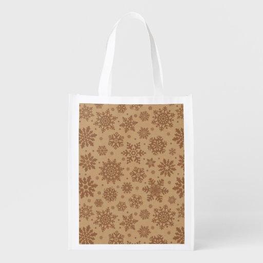 Copos de nieve en modelo de la cartulina bolsas de la compra