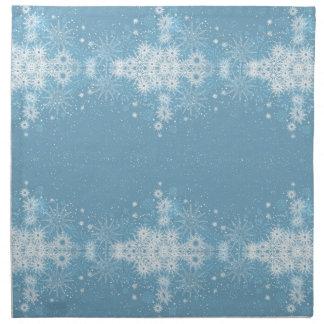 Copos de nieve en servilletas azules
