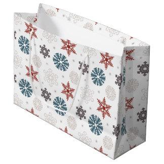 Copos de nieve patrióticos rojos y azules en el bolsa de regalo grande