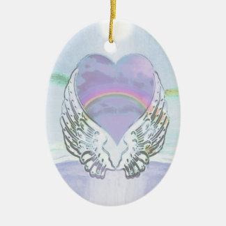 Corazón, alas del ángel y océano adorno navideño ovalado de cerámica