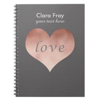 corazón color de rosa claro elegante del texto del cuadernos