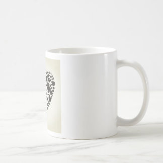 Corazón de la mano taza de café