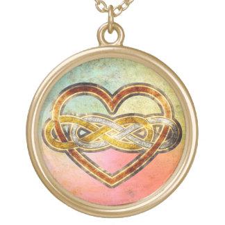Corazón doble del infinito del símbolo bicolor colgantes