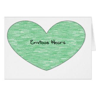 Corazón envidioso verde tarjeta