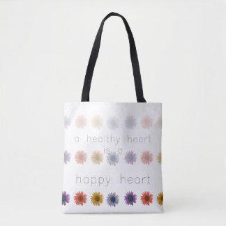 Corazón feliz sano por todo la bolsa de asas