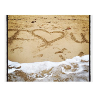 Corazón I usted escrito en la playa Postales