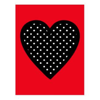 Corazón negro retro del lunar en fondo rojo postal