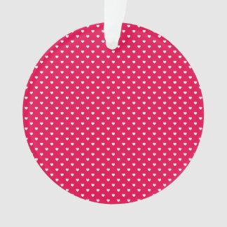 Corazones blancos de Polkadot en rosa del lápiz