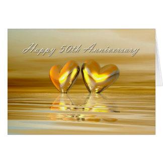 Corazones de oro del aniversario tarjeta