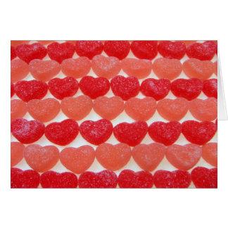 Corazones del caramelo en una fila tarjeta de felicitación
