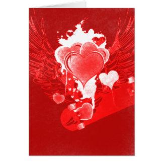 Corazones rojos con la tarjeta de la tarjeta del