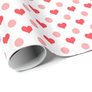 corazones rojos elegantes y modelo de lunares papel de regalo