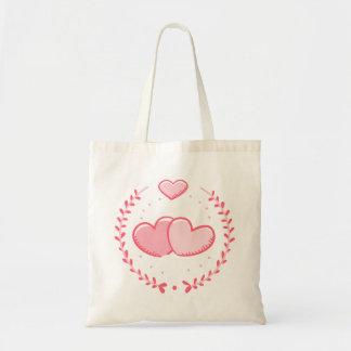 Corazones y amor rosados de la guirnalda del bolso de tela