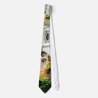 Corbata Azaleas por el pórtico con la silla de mimbre