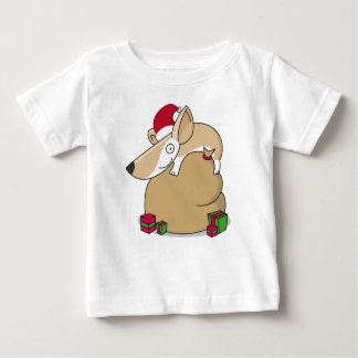 Corgi en un saco del navidad camiseta de bebé