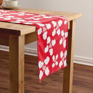 Corredor de la tabla de las ovejas rojas y blancas camino de mesa